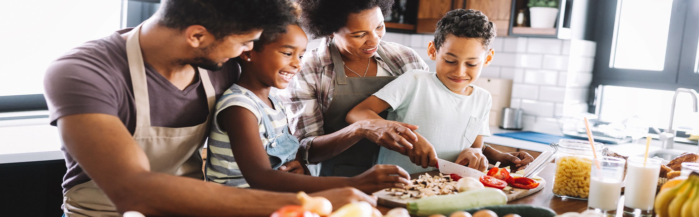 Image of family cooking in the kitchen